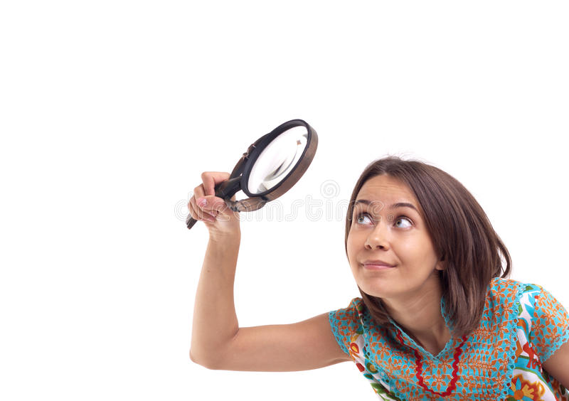 Picture of woman with magnifying glass. Isolated stock photos