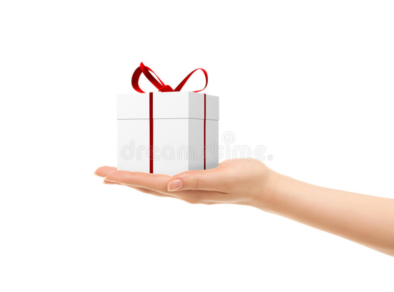 Picture of woman's hands holding a gift box. Isolated on white royalty free stock photo