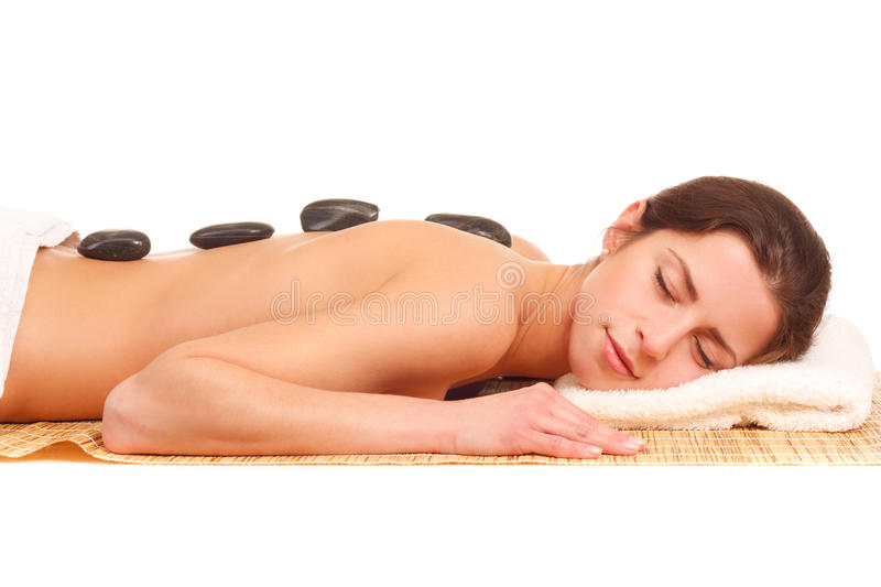 Picture of woman in spa salon with hot stones. Isolated royalty free stock photo
