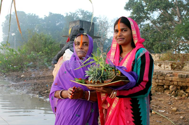 Womens Doing Chhath Puja. Picture of Womens doing Chhath Puja in the Morning at the occasion of Sun Rise Worship royalty free stock photography