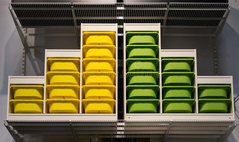 Organized Color Coordinated Storage Bins on a Shelf royalty free stock images