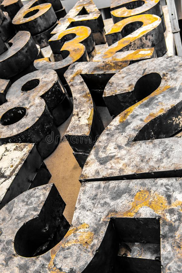 Yellow vintage rusty numbers stock images