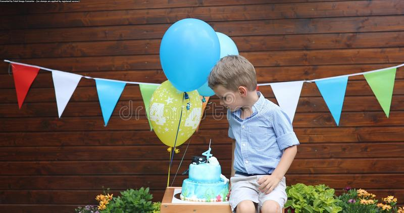 Picture of young boy at birthday party royalty free stock images