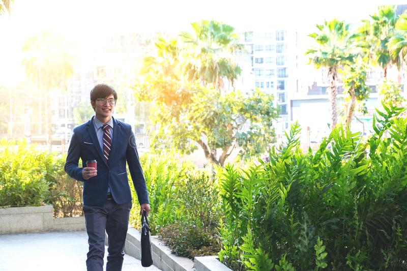 picture of a young business man walking forward with a briefcase royalty free stock image
