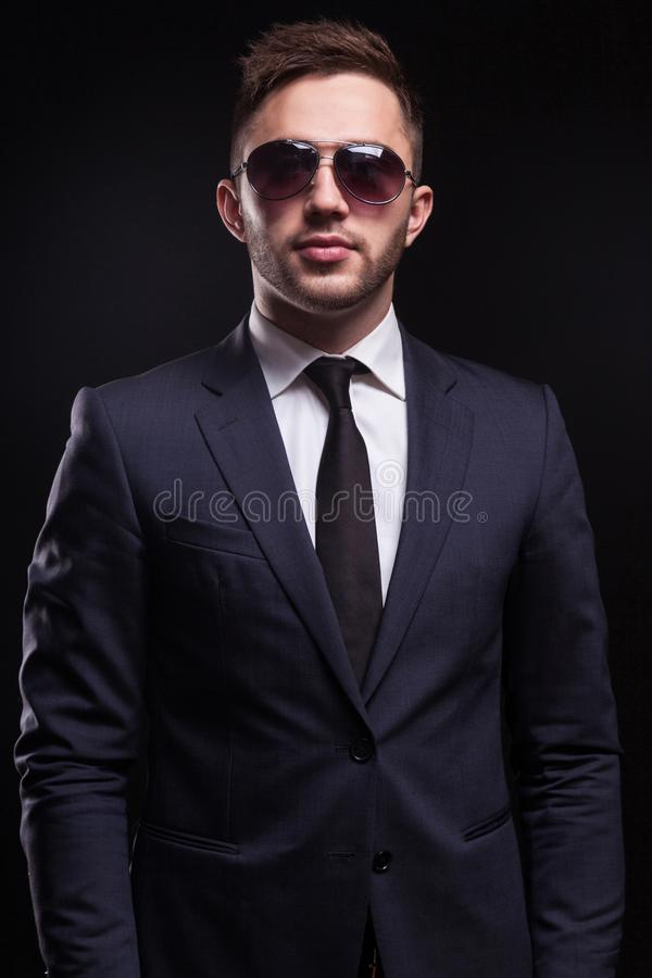 Picture of young businessman standing royalty free stock image