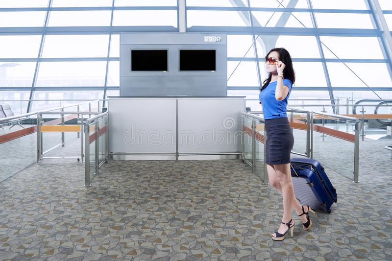 Young businesswoman walking in the airport royalty free stock image