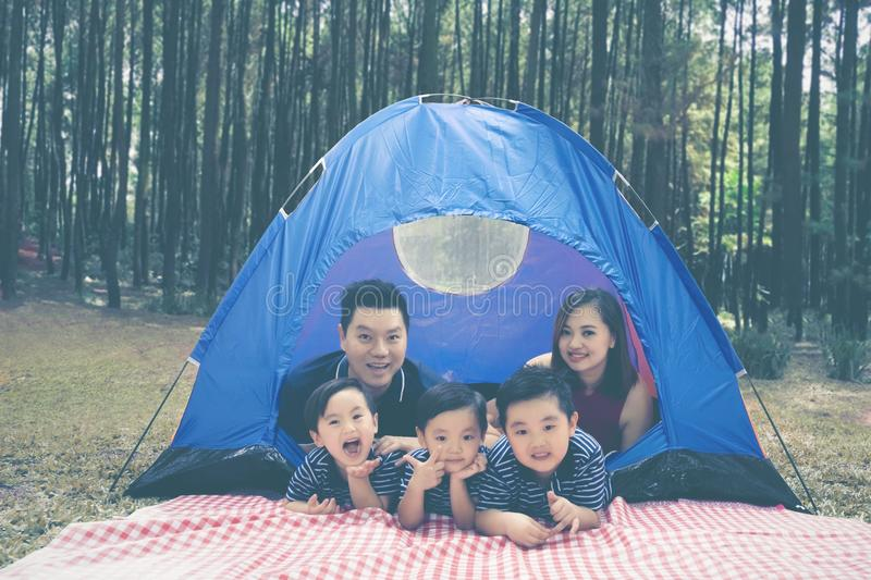 Young family lying in the tent stock photo