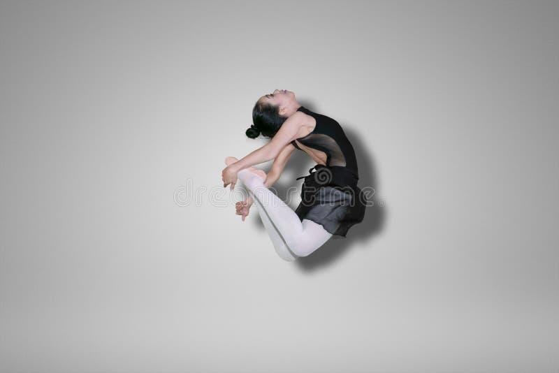 Young ballet dancer doing elegant leaps on studio stock images