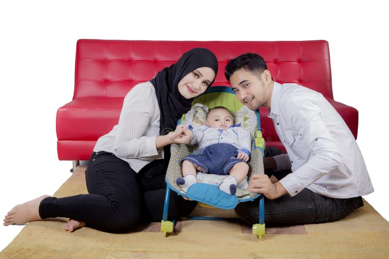 Young parents with their son on studio. Picture of young parents smiling at the camera with their son, isolated on white background royalty free stock image