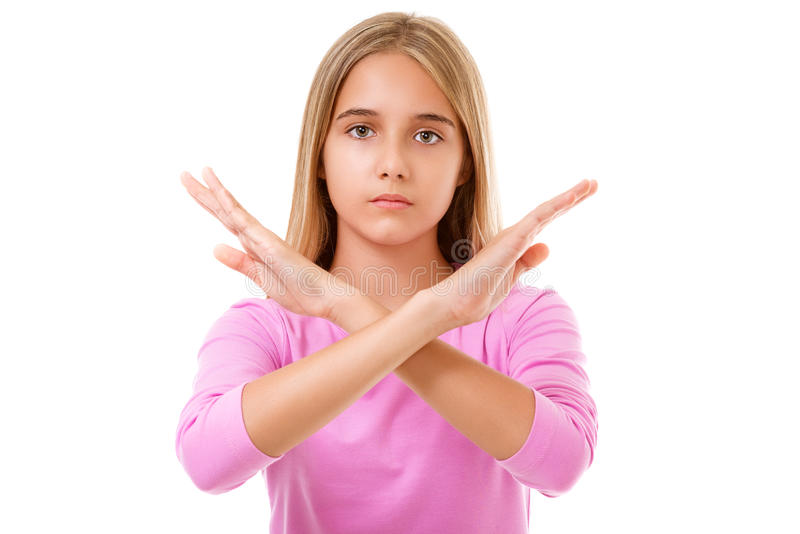 Picture of young teen girl making stop gesture.Isolated royalty free stock image