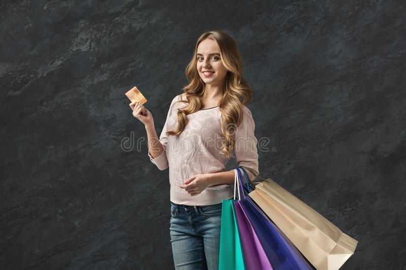 Picture of young woman with shopping bags royalty free stock images