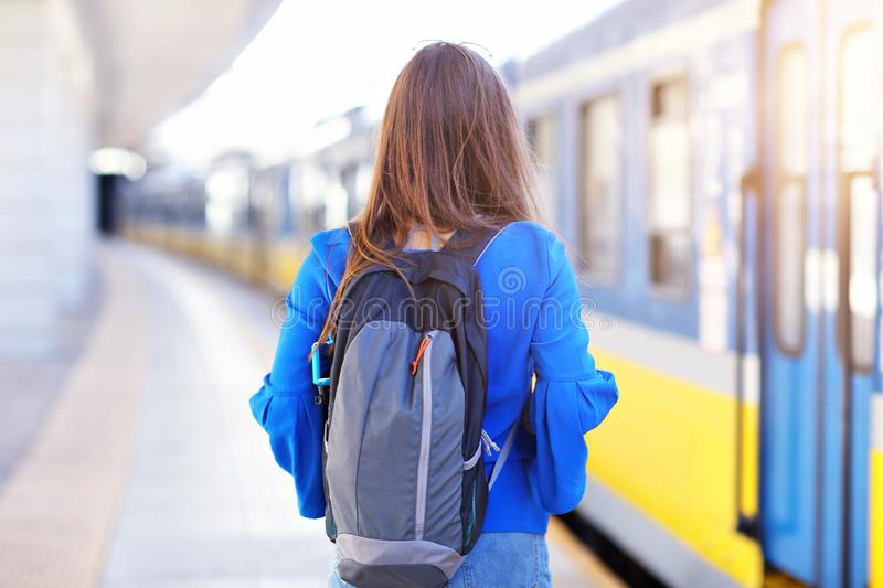 Young woman tourist at platform train station. Picture of young woman tourist at platform train station stock photography