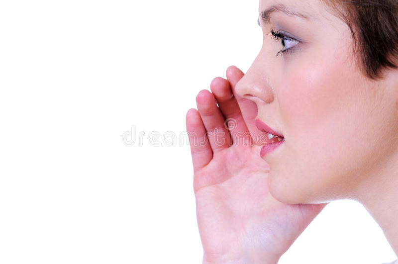 Picture of young woman whispering gossip royalty free stock photo
