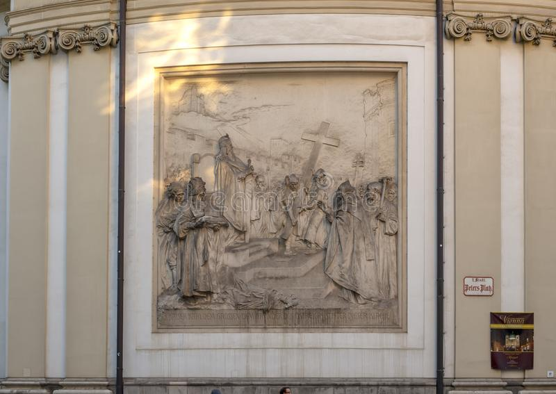 Bas-relief depicting the legend of the founding of St. Peter`s Church of Vienna by Charlemagne, 1906. Pictured is a bas-relief depicting the legend of the stock images