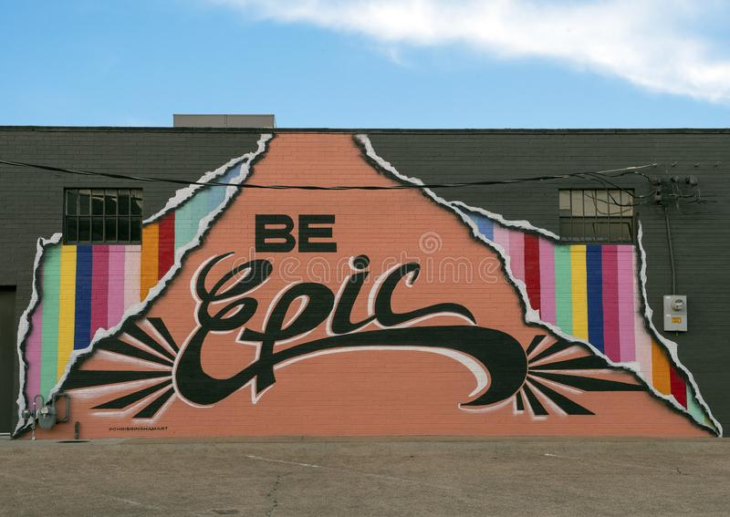 Be Epic mural by Chris Bingham, Dallas Design District. Pictured is the `Be Epic` mural by Dallas artist Chris Bingham.  It is located on the side of the royalty free stock image