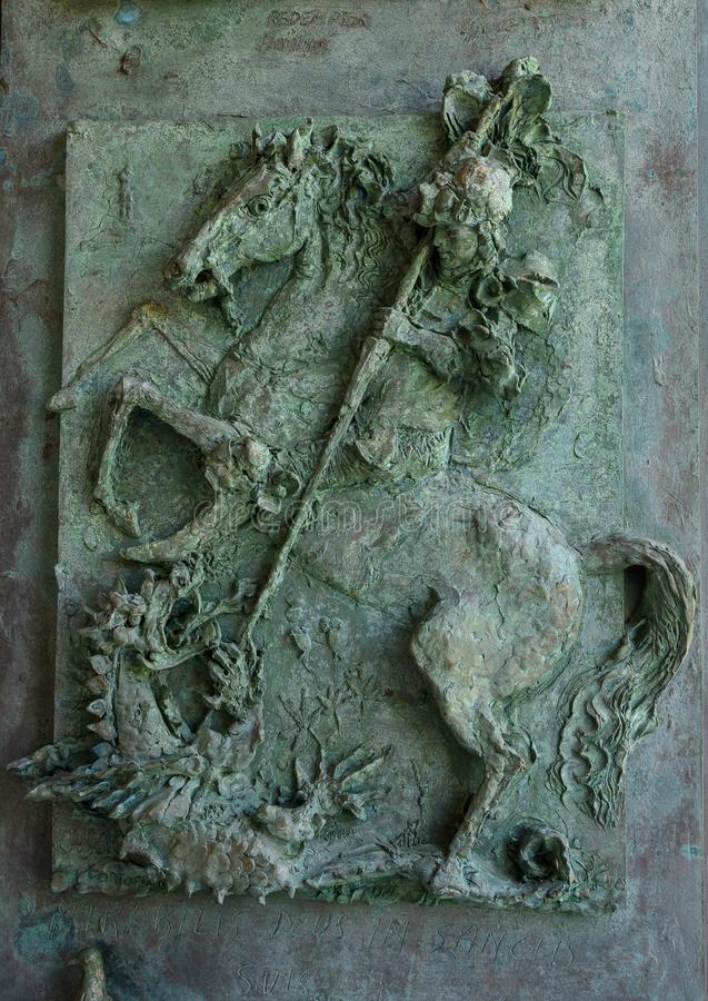 Bronze relief on door panel, Church of San Giorgio atop a hill in Portofino, Italy. Pictured is a bronze door panel of the Church of San Giorgio atop a hill in royalty free stock images