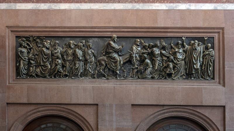 Bronze relief Jesus on Donkey and disciples, interior Esztergom Basilica, Esztergom, Hungary royalty free stock images