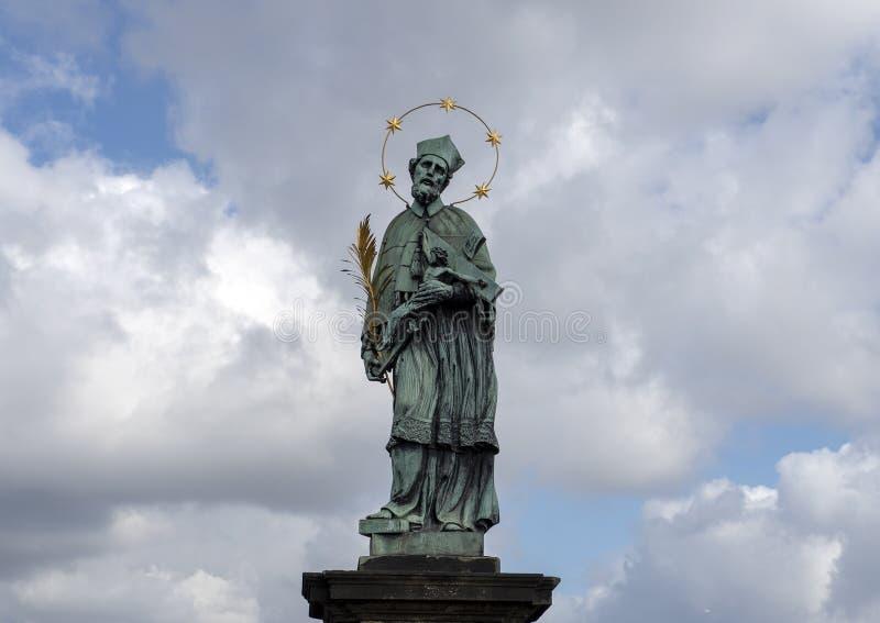 Saint John of Nepomuk on the Saint Charles Bridge in Praque, capital of the Czech Republic. Pictured is a bronze statue of Saint John of Nepomuk on the Saint royalty free stock photography