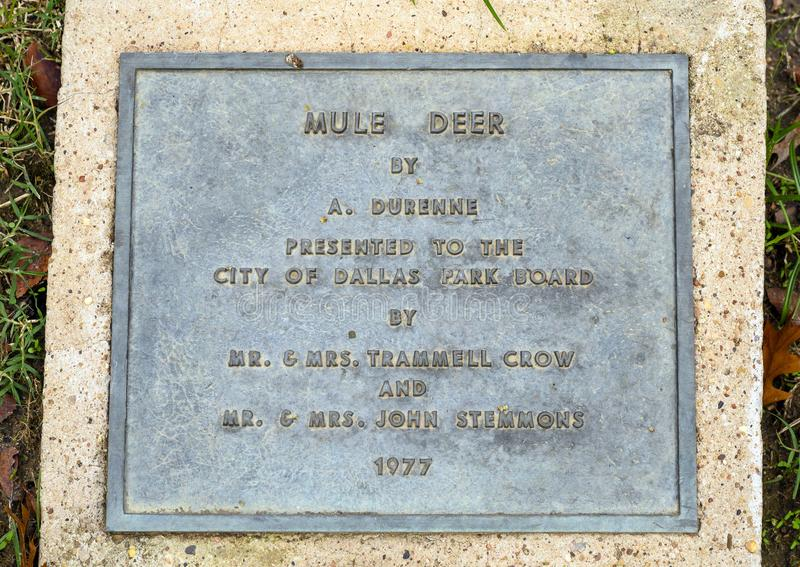 Information plaque for `Mule Deer` by A. Durenne in Turtle Creek Park in Dallas, Texas. Pictured is a cast iron sculpture titled `Mule Deer` by A. Durenne in stock photos