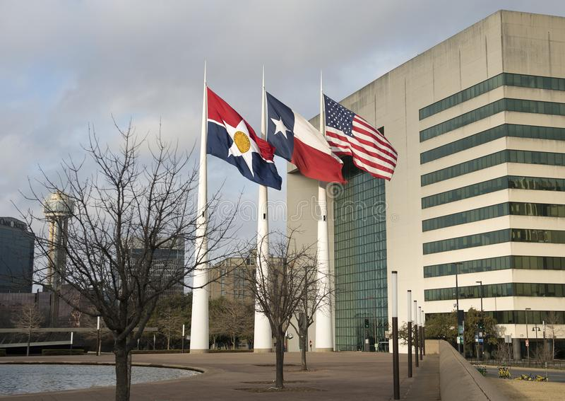 Flags flying in front of Dallas City Hall, seat of municipal government. Pictured are the City of Dallas, Texas, and American Flags flying in front of Dallas royalty free stock image