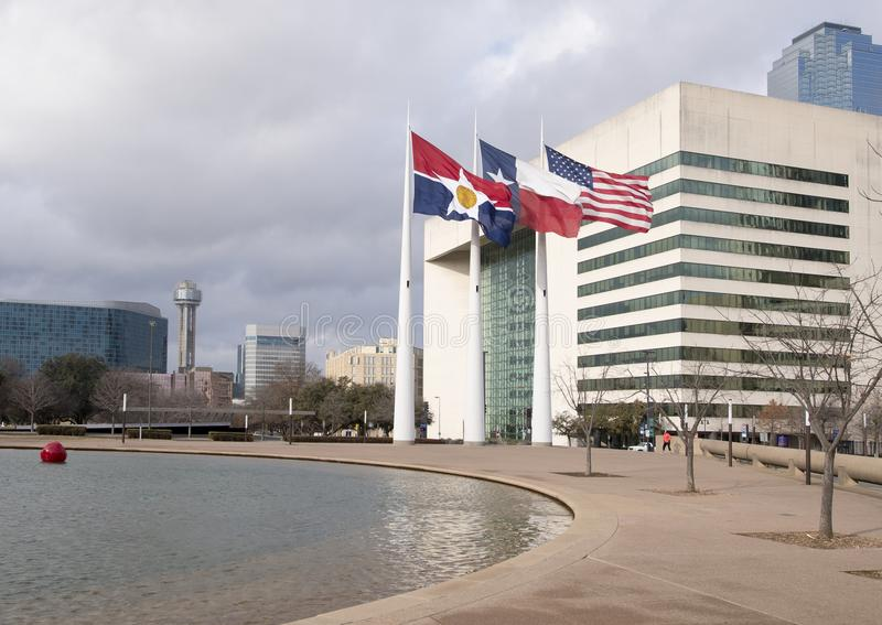 Flags flying in front of Dallas City Hall, seat of municipal government. Pictured are the City of Dallas, Texas, and American Flags flying in front of Dallas royalty free stock photography
