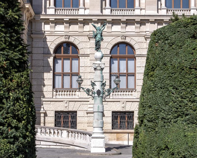 Classic lampost topped with bronze green angel statue, front of the Natural History Museum, Maria-Theresien-Platz, Vienna, Austria stock photos