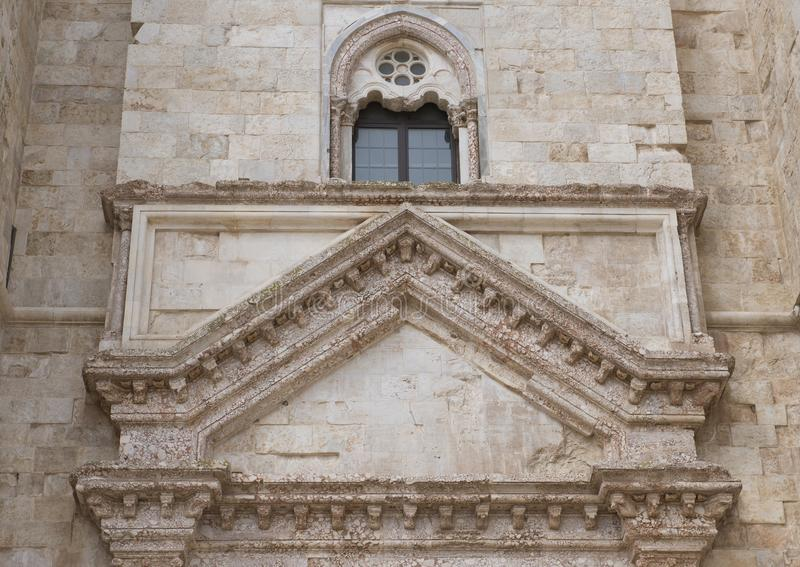 Front window Castel Del Monte in Andria in southeast Italy. Pictured is a closeup view of a front window of the Castel Del Monte. Castel del Monte is Italian for royalty free stock photos