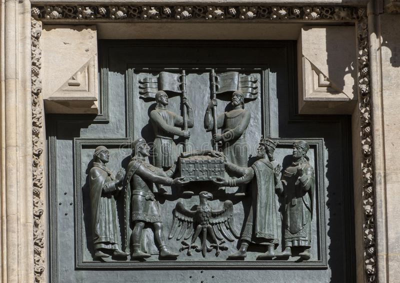 Closeup view of the Great West Door, St. Vitus`s Cathedral, Prague Castle, Czech Republic. Pictured is a closeup view of a panel in the Great West Door, St stock photos