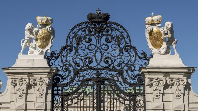 Closeup view elaborate wrought iron gate at entrance to the Upper Belvedere Palace, Vienna, Austria. Pictured is a closeup view of the top of the elaborate royalty free stock photography