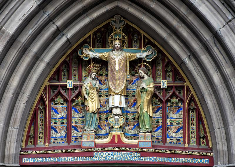Pictured a closeup view of `Christ in Majesty`, above front door of Saint Mark`s Episcopal Church, Philadelphia, Pennsylvania royalty free stock images
