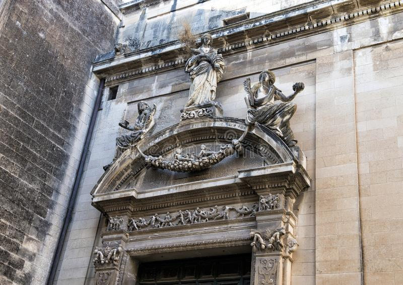 Closeup view side entrance Church of Saint Irene, Lecce. Pictured is a closeup view of the top of a side entrance to the Church of Saint Irene in Lecce, Italy. A stock image