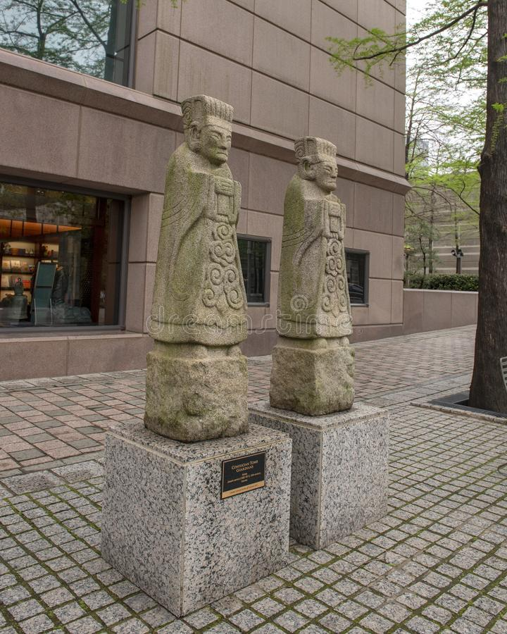 Confucian tomb guardians on the street outside the Crow Museum of Asian Art in downtown Dallas, Texas. Pictured are Confucian tomb guardians on the street royalty free stock photography