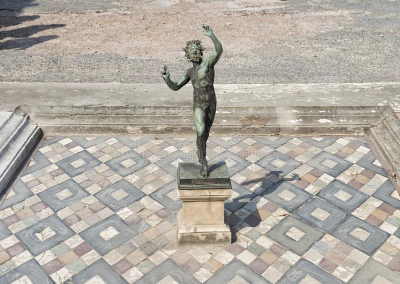 Mosaic three dimensional tile floor in the House of Faun, Scavi Di Pompei. Pictured is a dancing statue of faunus,the god of wild nature and fertility, also royalty free stock photos