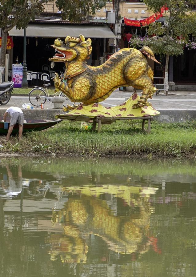 Dragon structure with it`s reflection in Thu Bon River, Hoi An, Vietnam. Pictured is a dragon structure with it`s reflection in Thu Bon River, Hoi An, Vietnam royalty free stock photography