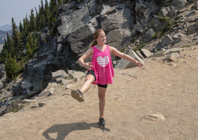 Eleven year-old Caucasian girl posing in Mount Rainier National Park, Washington stock photography
