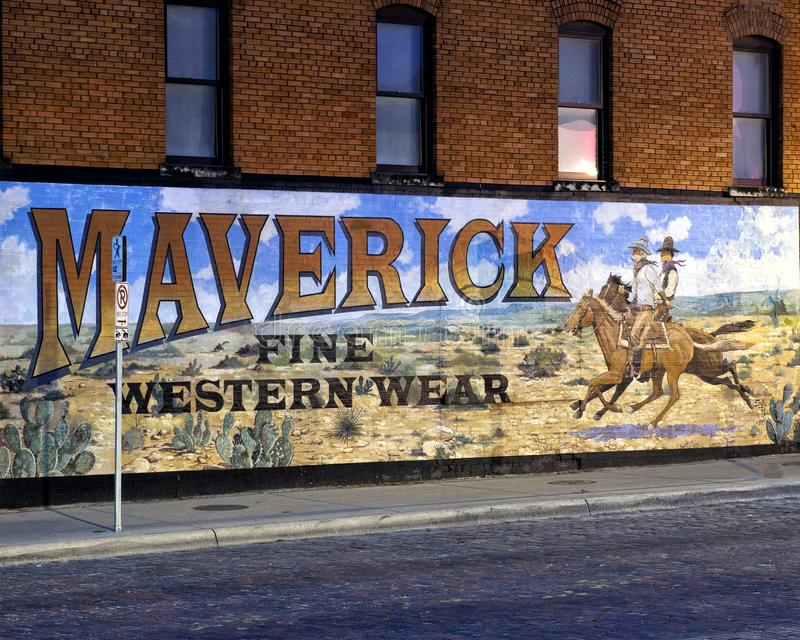 Exterior mural by Western artist Stylle Read, on the side of the building that houses Maverick Fine Western Wear. Pictured is an exterior mural by Western artist stock photos