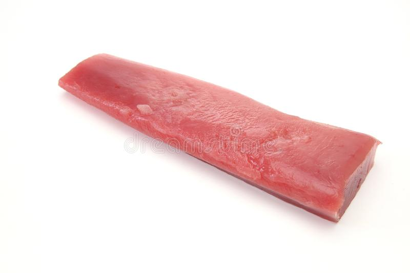Fillet of raw tuna in a white background. Pictured fillet of raw tuna in a white background stock photos