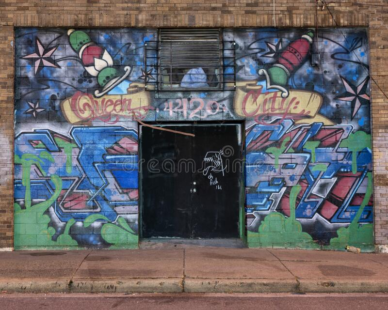 Pictured is the former site of a tatoo parlor, Queen City at 115 N. Carroll AVenue in Dallas, Texas. Pictured is the front of a former tattoo parlor, Queen City royalty free stock images