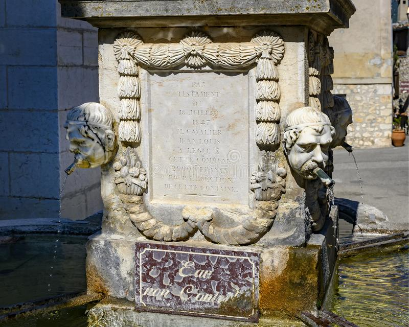 1852 Fountain dedicated to Jean-Louis Cavalier in Gourdon Village, France. Pictured is an 1852 Fountain dedicated to Jean-Louis Cavalier in Gourdon Village stock photography
