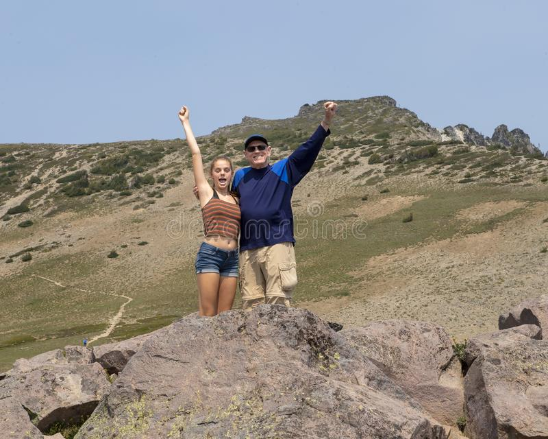 Fourteen year-old granddaughter and her grandfather having fun in Mount Rainier National Park, Washington stock photos