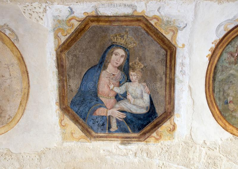 Maddona and Child in the Museo Nazionale D& x27;Arte Medievale in Matera Italy. Pictured is a framed painting of the Madonna and Child. It is located in the royalty free stock image
