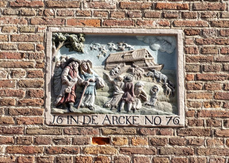 Gable Stone depicting biblical story of Noah`s ark, Amsterdam, The Netherlands. Pictured is a gable stone on a home in Amsterdam titled J6 in DE ARCKE NO 76`. It royalty free stock photos