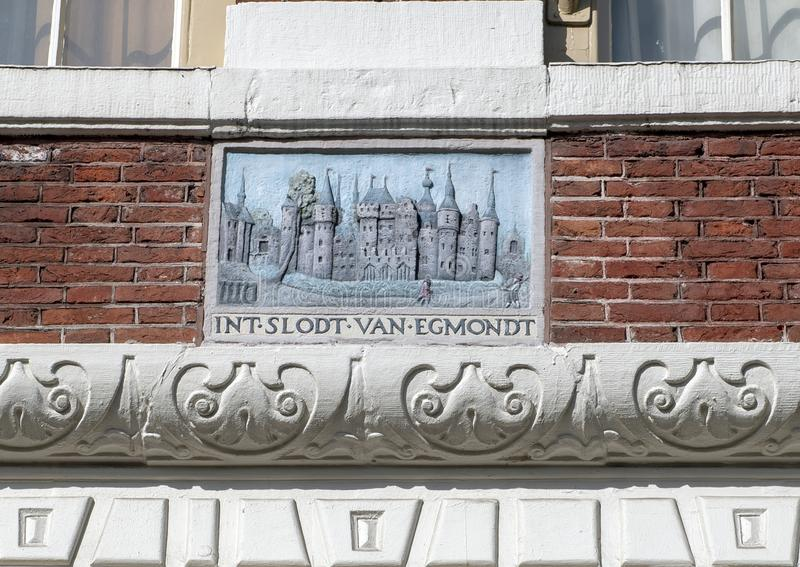 Gablestone `INT SLODT VAN EGMONDT`, Amsterdam, The Netherlands. Pictured is a gable stone with relief of Ancient Amsterdam and the inscription `INT SLODT VAN stock images