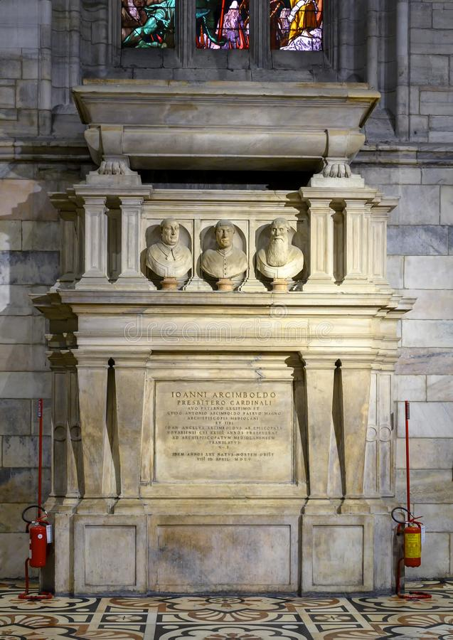 Grave built by Giovanni Angelo Arcimboldi, archbishop of Milan, inside the Milan Cathedral. Pictured is a grave built by Giovanni Angelo Arcimboldi, archbishop stock image