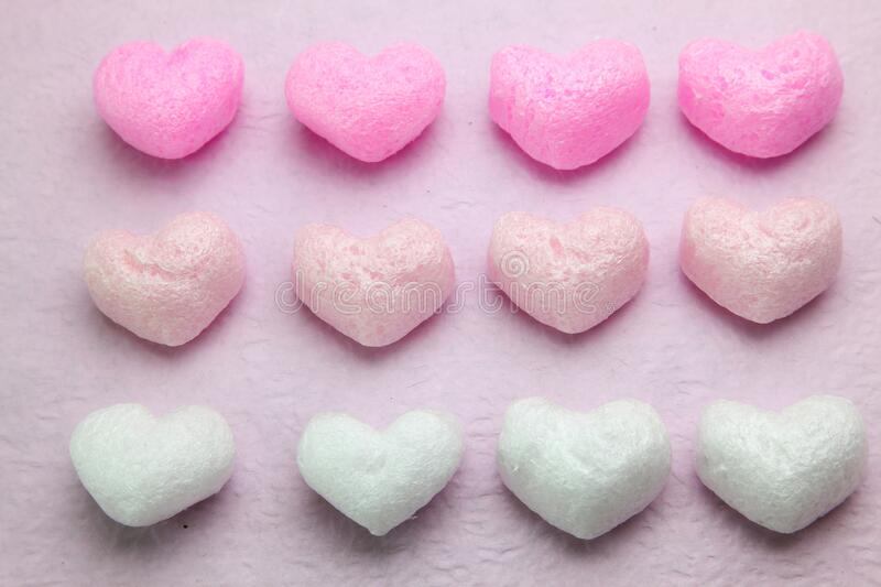 Heart shaped packing material in pink background. Pictured heart shaped packing material in pink background royalty free stock photography