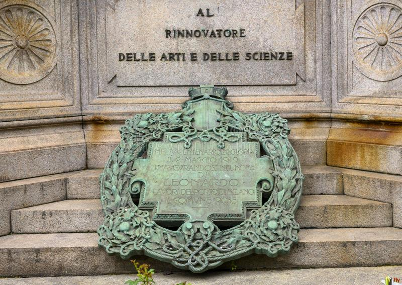 Inauguration Plaque, front of the monument to Leonardo Da Vinci in Piazza della Scala Square, Milan, Italy. Pictured is the inauguration plaque at the front stock photos