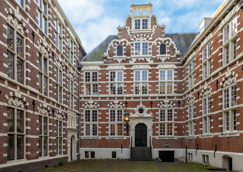 Inner Couryard of the Oost-Indisch Huis, Amsterdam, The Netherlands. Pictured is the inner courtyard of the Oost-Indisch Huis, an early 17th-century building in royalty free stock image