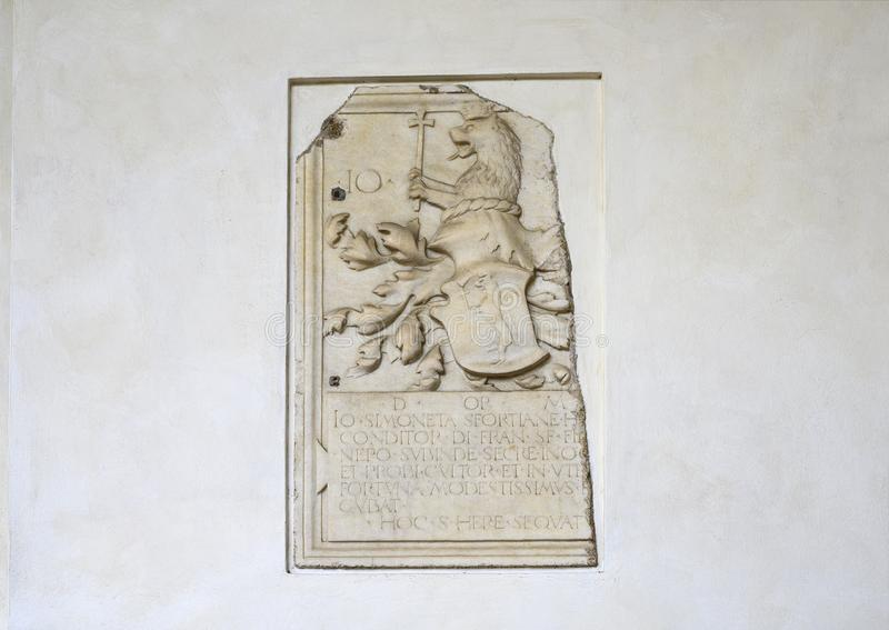 Relief of a heraldic lion with crown and cross on a wall of the Refectory at Santa Maria delle Grazie, Milan, Italy. Pictured is a marble relief of a heraldic stock photo