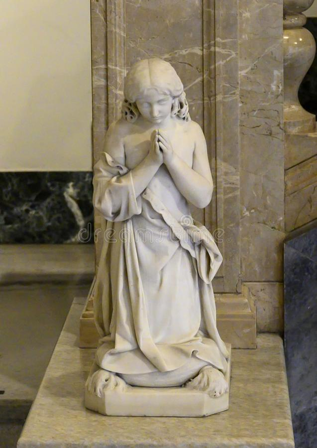 Marble sculpture of girl praying inside The Pinacota Ambrosiana, the Ambrosian art gallery in Milan, Italy stock photo