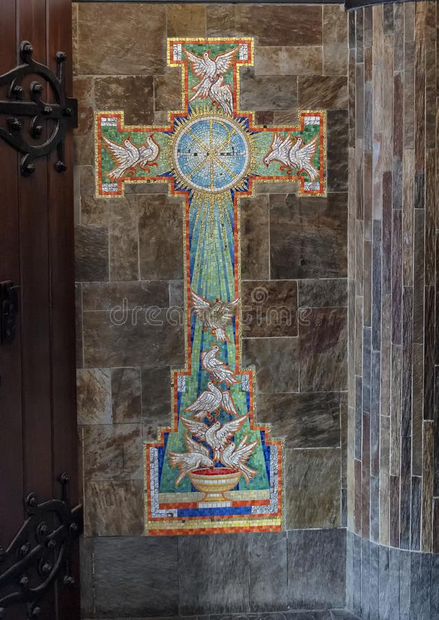 Pictured is a mosaic cross with white doves, Amsterdam, The Netherlands stock image